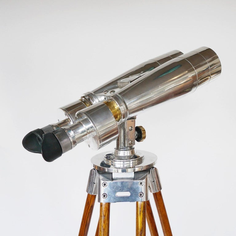 Fuji Meibo 15X80 marine binoculars on later extending wood and chromed metal stand with chromed conical feet. 15X magnification with 80m objective lens.   Numbered 6526.  Stamped Fuji Meibo and numbered.   Dimensions: H 50cm W 21cm Length 50cm