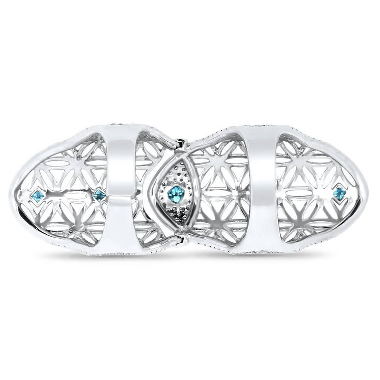 Material: 14k White Gold Colored Diamonds: 5 Natural Fancy Round Blue Diamonds at 0.60 Carats - SI Quality Mounting Diamond Details: 200 Brilliant Round Diamonds at 0.98 Carats SI Quality, H-I Color Ring Size: Size 7. Alberto offers complimentary