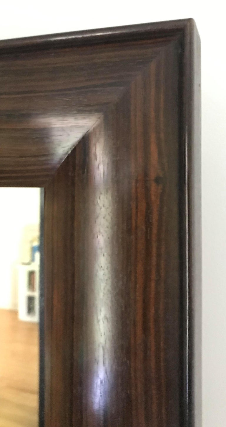 Full length dressing mirror in Macassar Ebony.  Customizable in any exotic wood. A wonderful compliment to the perfect master bedroom or dressing room. The width can be expanded or contracted by opening and closing. The mirror can also be customized