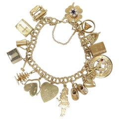 Full of Charms 1950s Charm Bracelet 14 Karat Yellow Gold