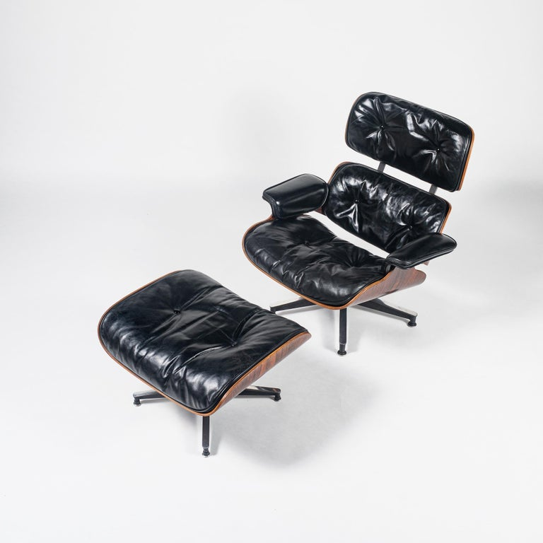 Rare collected 1956 Eames Lounge Chair with ottoman includes all the original details: -three screw armrests -down feather filled cushions -shell stamped number 82. New shock mounts, original leather with original down feather pillow re-fluffed. Two
