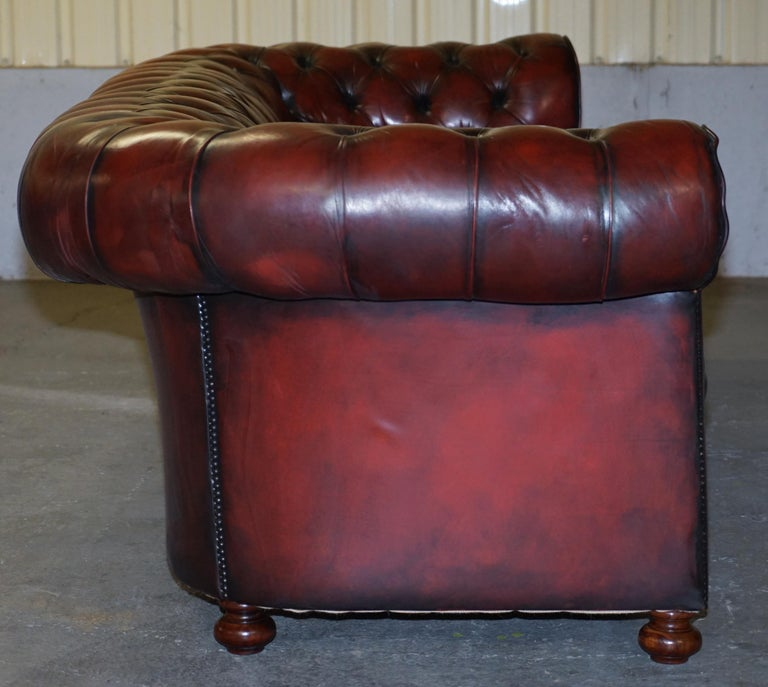 Fully Restored Hand Dyed Oxblood Leather Fully Tufted Chesterfield Buttoned Sofa For Sale 8