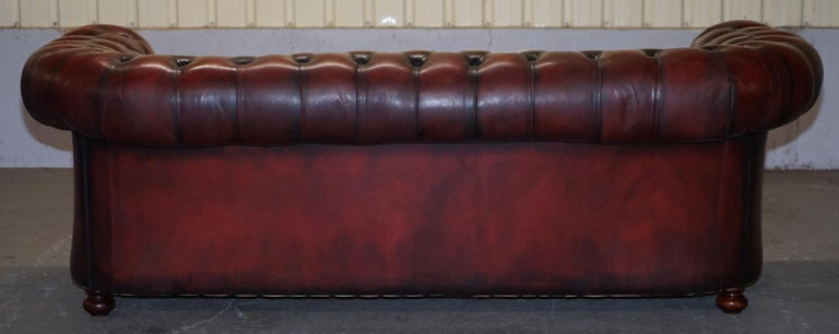 Fully Restored Hand Dyed Oxblood Leather Fully Tufted Chesterfield Buttoned Sofa For Sale 9