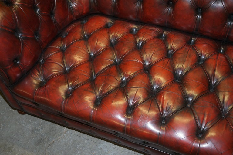 Late 19th Century Fully Restored Hand Dyed Oxblood Leather Fully Tufted Chesterfield Buttoned Sofa For Sale