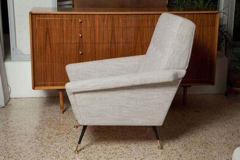 Fully restored pair of 1950s Italian lounge chairs, upholstered in a thick grey and cream interwoven Belgian linen.