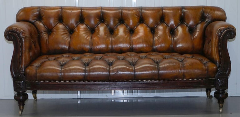 We are delighted to offer for sale this very rare fully restored Chesterfield Victorian show frame sofa in rosewood with hand dyed brown leather