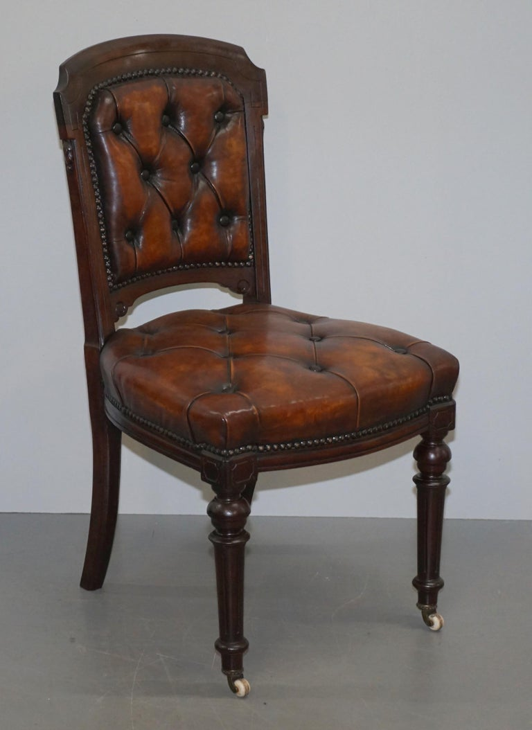 We are delighted to offer for sale this very rare suite of fully restored Victorian chesterfield brown leather dining chairs  These are a very important and substantial set of chairs, they have been fully restored to include the timber being