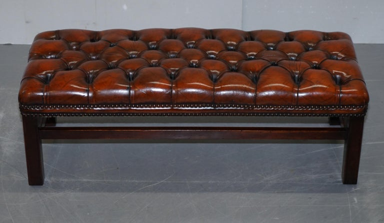 We are delighted to offer for sale this stunning fully restored hand dyed brown leather Chesterfield bench footstool  A very good looking and well made piece, it has been reupholstered with high grade leather which has been hand dyed this nice