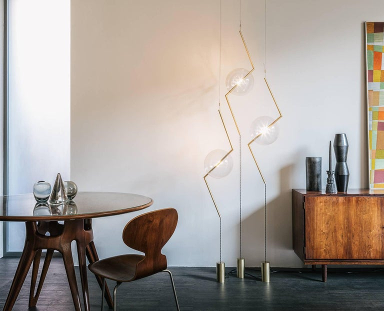 Somewhere between a Suspension Light and a Floor Lamp, Fulmine (thunderbolt) engages with gravity in an innovative and Playful way. The Central Form, stretched from each end, seems to resist its own, emerging, Lightning-Bolt zig-zag Form, creating
