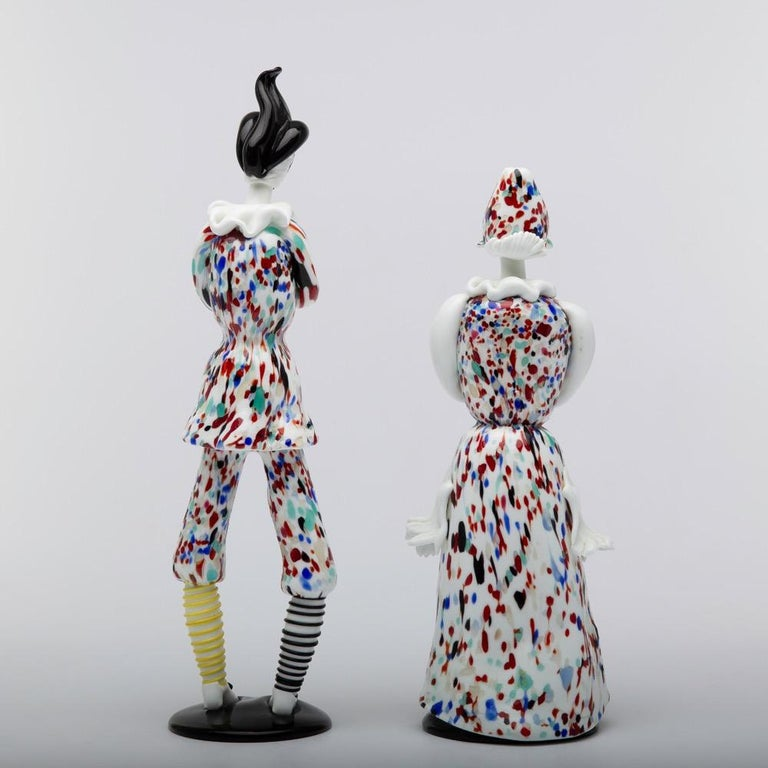 A rare pair of figurines designed by Fulvio Bianconi, manufactured by Venini Murano in Italy, circa 1955. In lattimo glass with polychrome decorations on a circular black glass base. Known as model 2908 - exhibited Venice 26th Biennale in