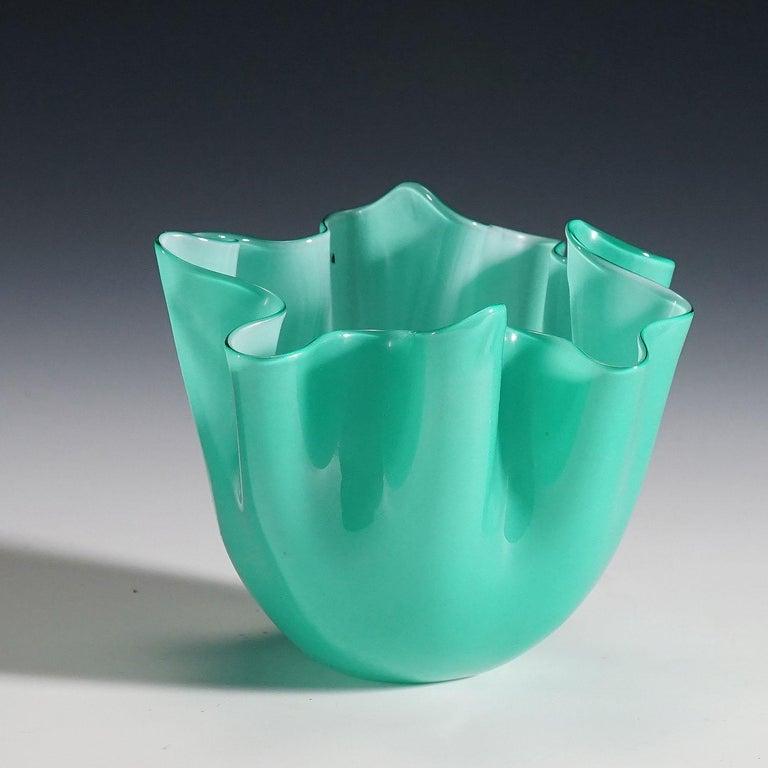 A small fazzoletto vase in lattimo and green glass designed by Fulvio Bianconi in 1950, manufactured by Venini, Venice, circa 1960. Acid stamped signature 'Venini Murano italia' on the base. Model no. 3927. Lit.: marino barovier with carla sonego,