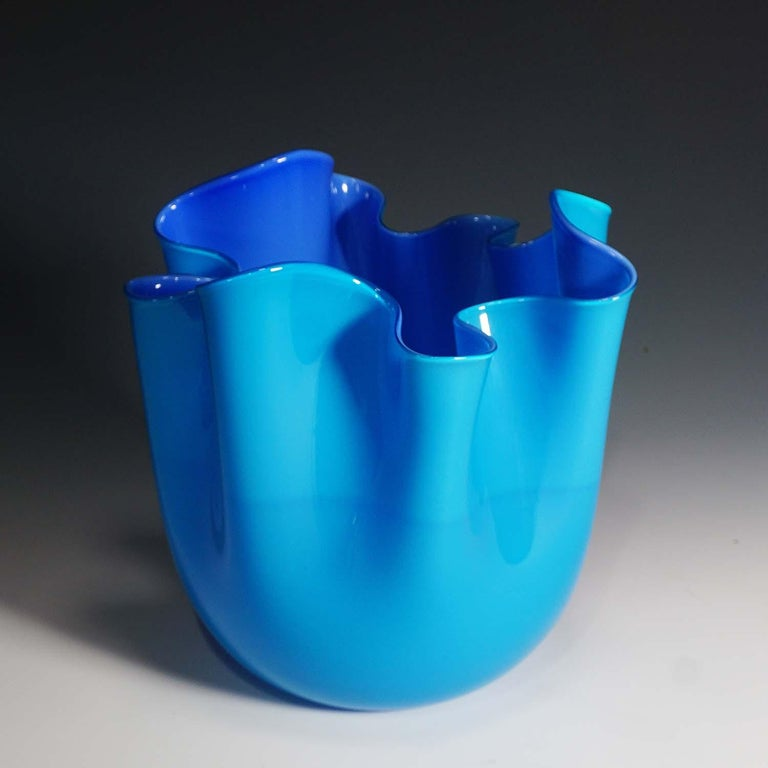 A fazzoletto opalino vase in blue and light blue glass designed by Fulvio Bianconi in 1950, manufactured by Venini, Venice. With Venini lable and incised signature