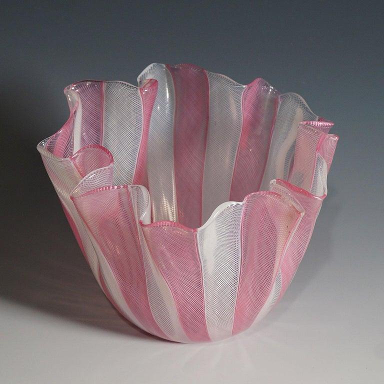 A Fazzoletto vase in white and pink Zanfirico glass designed by Fulvio Bianconi in 1950, manufactured by venini, venice. Acid etched signature 'venini murano italia' on the base. A tiny black inclusion on the rim. model no. 4217.  Lit.: marino