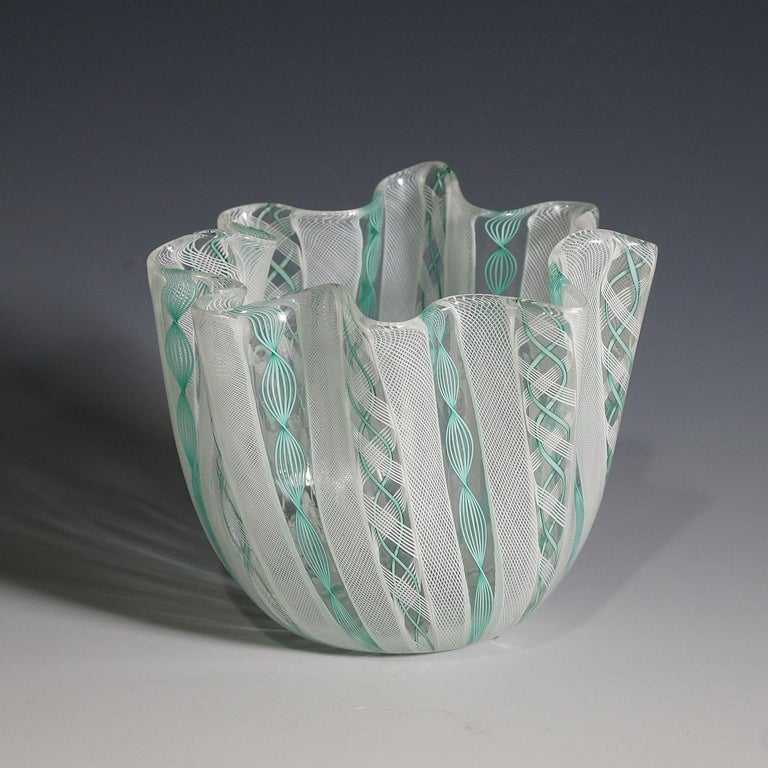 A Fazzoletto vase in white and light green Zanfirico glass designed by fulvio bianconi in 1950, manufactured by Venini, Venice. With vintage venini lable on the base (etched signature not visible - probably underneath the lable). Model no.