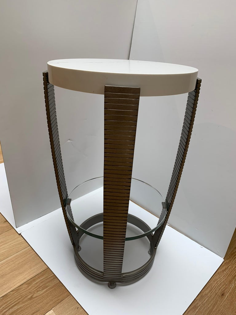 Iron Art Deco side table, with polished white marble top, and glass shelf at stretcher.