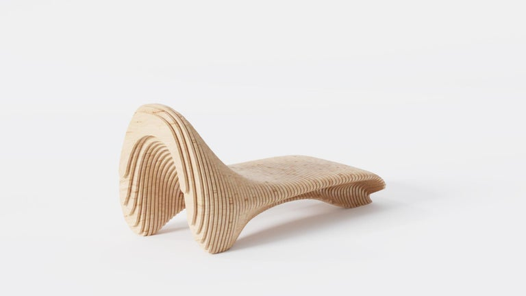 This Handmade Functional Sculptural Parametric Teak Sun Chair by John Brevard is 1 of a series of 25 pieces in the collection. Unlike other contemporary pieces, this piece is hand made and carries the wear and form of a handmade piece. 