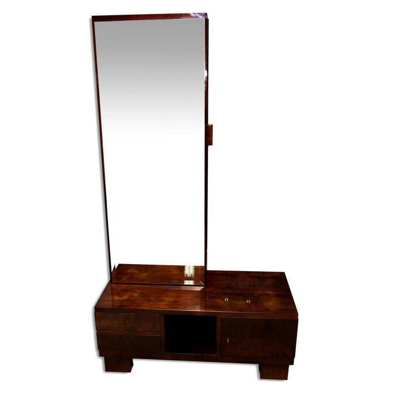 Luxurious functionalist vanity or dressing table-mirror with a drawer for toiletries on the side. It was made of solid wood with walnut veneer. The mirror is equipped with a storage space at the bottom. Very interesting design. It was made in the