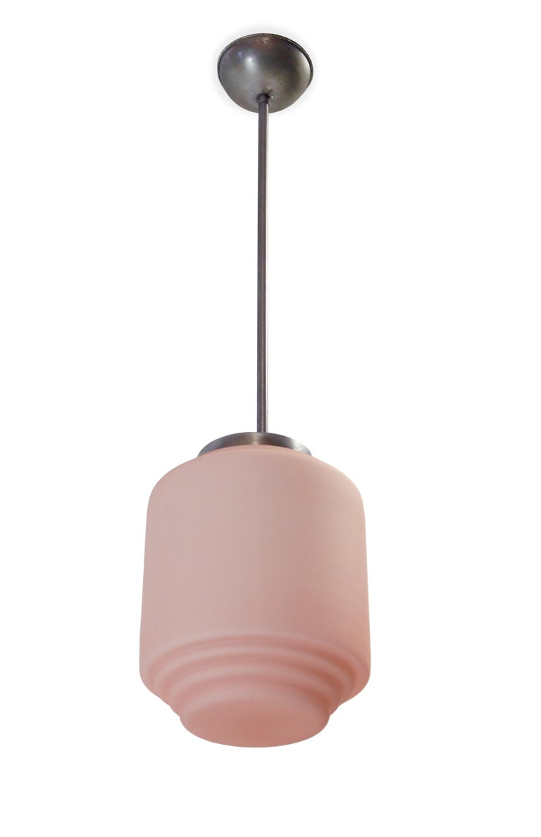 Decorative and rare ceiling light in pink opaline glass shade and chrome stem. Most likely designed and made in Sweden from circa first half of the 1950s. The lamp is fully working and in excellent vintage condition.