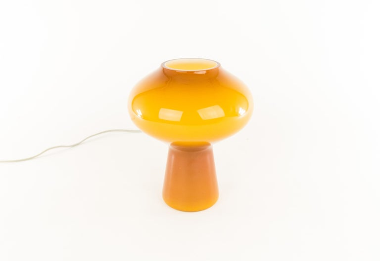 A handblown amber colored glass Fungo table lamp designed by Massimo Vignelli at the start of his impressive career in design and executed by Murano glass specialist Venini.