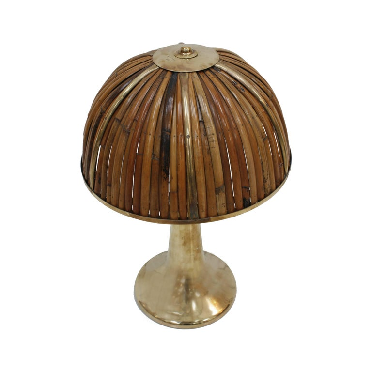 """Fungo"" table lamp designed by Gabriella Crespi, from the ""Rising Sun"" series with bell-shaped brass base and bamboo dome screen. Signed at the base and in the shade by Gabriella Crespi, Italy, 1974."