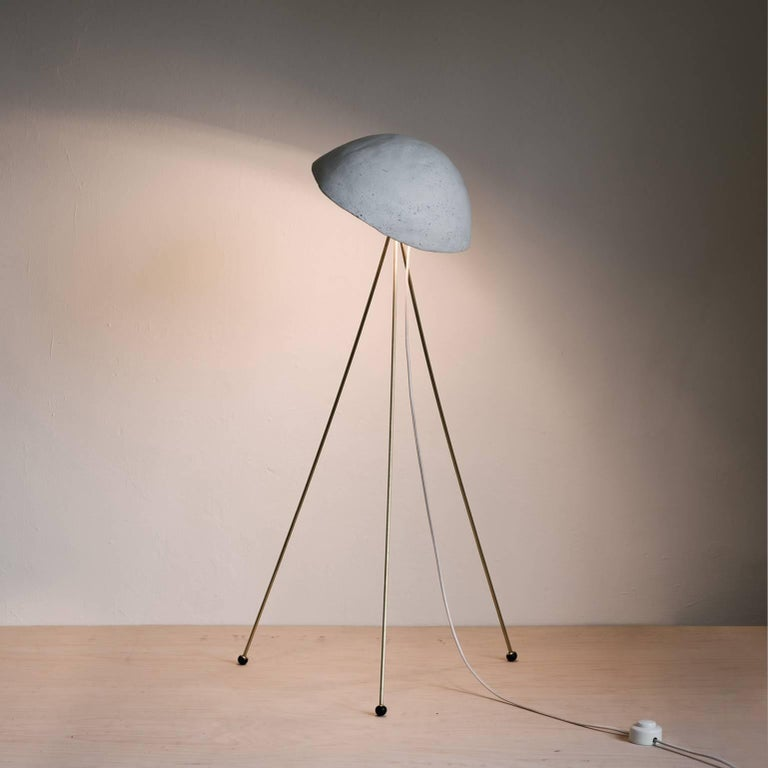 Funny Buddy Floor Lamp With Concrete Noggin And Brass Tripod Legs For Sale At 1stdibs