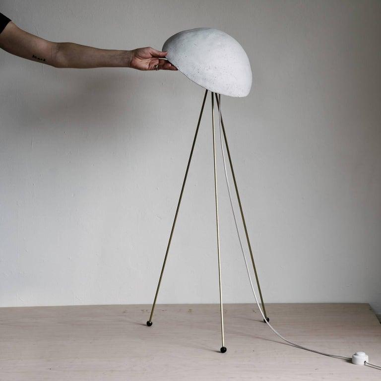 American Funny Buddy Floor Lamp with Concrete Noggin and Brass Tripod Legs