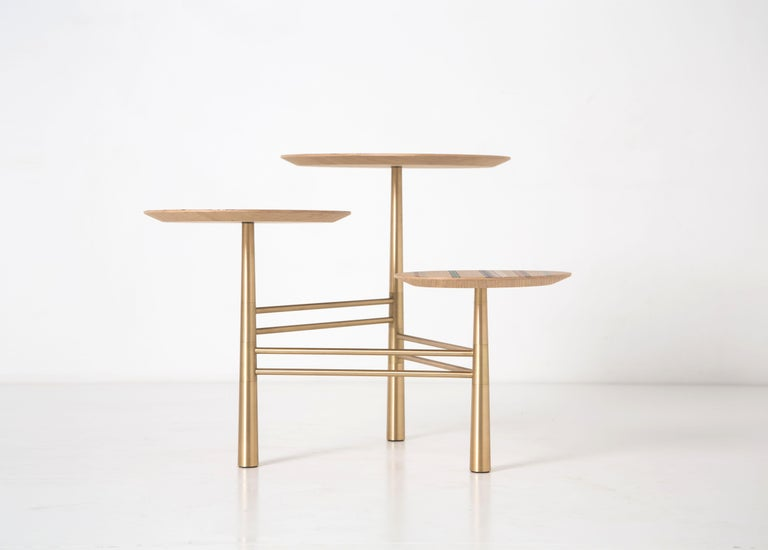 A variation of the pebble table; static and in three legs. The removable French oak tops are animated with marquetry strips.
