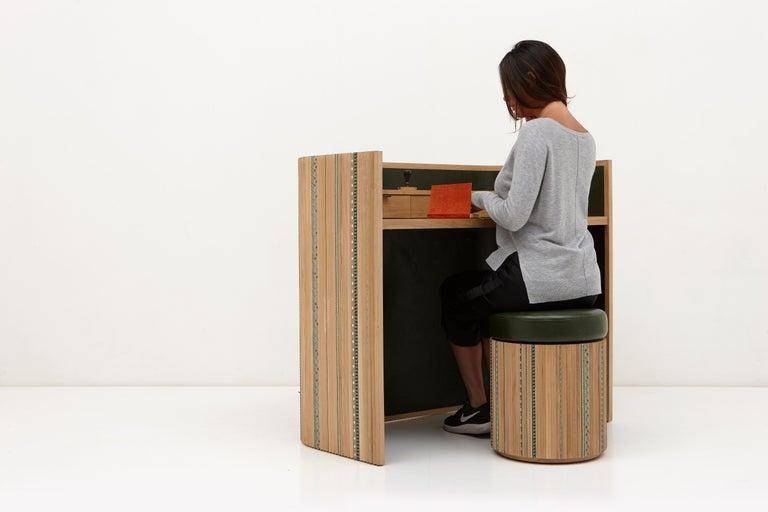 The aim of this collection is to create a new dialogue around craft that has room for playfulness and joy too. It is reflected in the Funquetry pleated secretaire, a compartment desk where strips of different colored wood are sliced and then applied