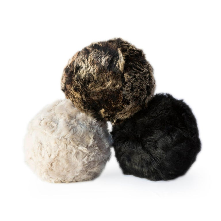 The snowball fur pillow is made from glove factory remnants we have sewn into a custom fabric to provide sustainable,