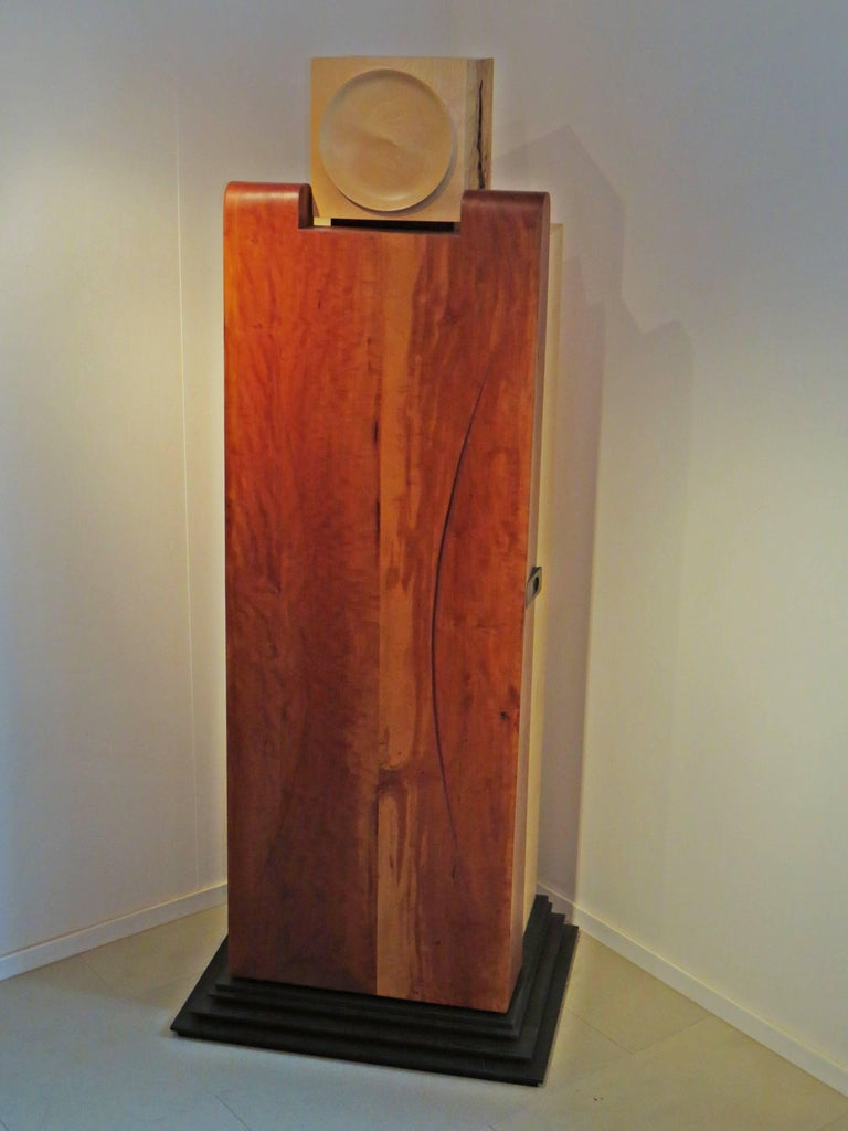 This cabinet sculpture was created by the German sculptor and furniture maker Eckehard Weimann. An abstract human represents this furniture. The head of fused maple with turned flap. The pannier door made of pear wood, with organically elaborated