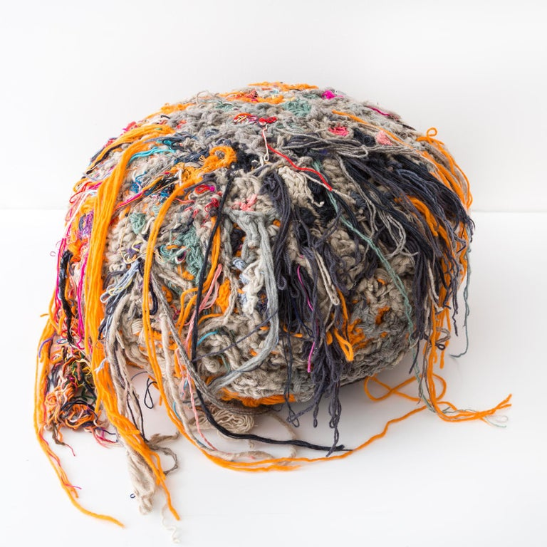 Further Forms are a grouping of bright and hairy ottomans that have creature-like qualities. Tamika Rivera sculpts the Forms by wrapping, knitting and knotting yarn and string onto stuffed geometric forms. She builds off these forms to create this