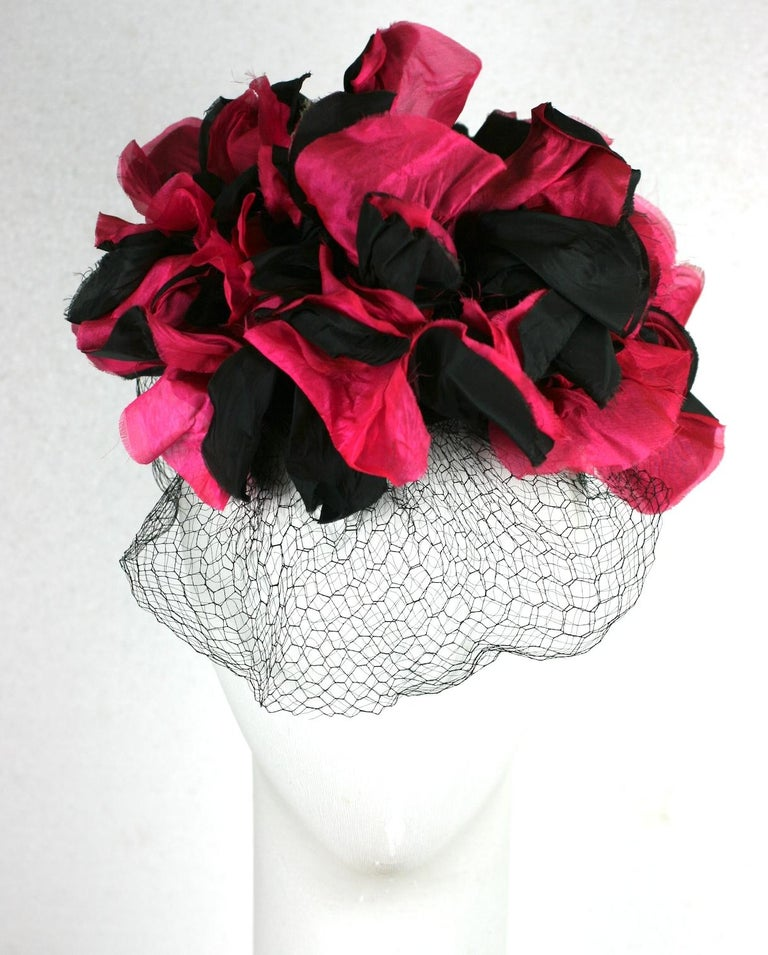 Dramatic Fuschia and Black Silk Flower Topper or Fascinator from the late 1930's. Large silky blooms perched on a tiny cap with self fabric wire covered hoop, elastic band and front silk veil. Retailed at Burdines, with original price tag. Late