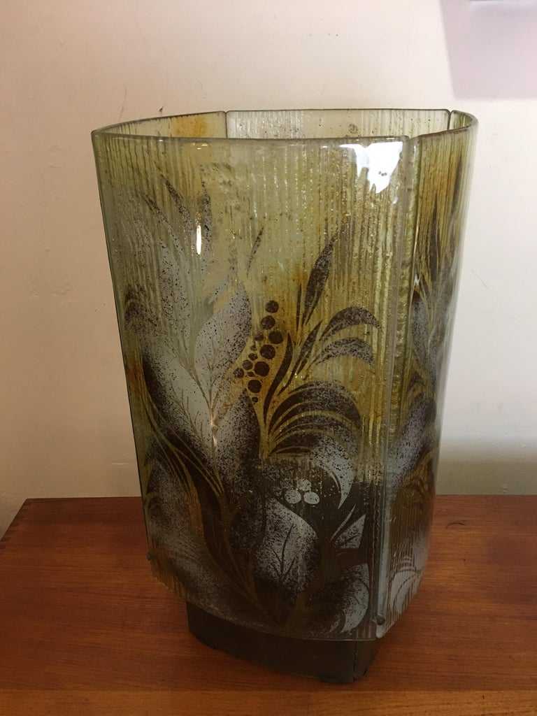 Fused or slumped glass table lamp. Made up of 4 slightly curved pieces of glass. Each panel has a leafy design motif. Base is also 4 pieces of glass. Technique is similar to Frances and Michael Higgins, American glass workers who specialized in