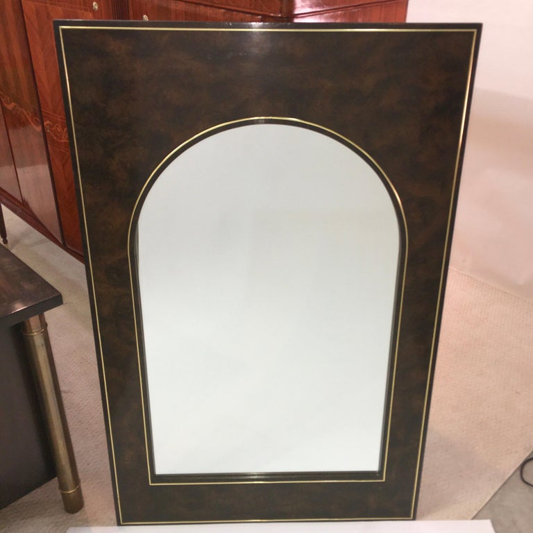 Large rectangular vertical wall mirror designed by William Doezema for Mastercraft Furniture Company circa 1974. Carpathian elm burl with brass trim inset with Futurist style arch form mirror (a la Palazzo della Civilta, Roma). See image