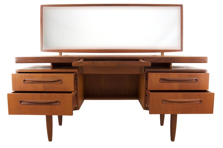 Beautiful five-drawer 1960s teak dressing table or vanity by G-Plan in outstanding condition. Designed by Victor Bramwell Wilkins for G-Plan during the Mid-Century Modern era in Britain. Bramwell was well known for his