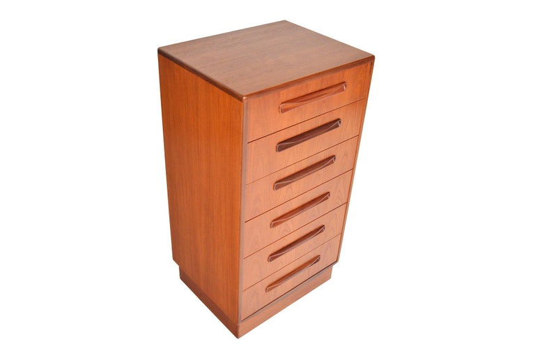 This English modern G Plan Fresco lingerie chest was designed by Victor Wilkins in the 1960s. This fantastic dresser features six deep drawers with solid teak drawer fronts and carved afrormosia pulls. With its slender design, this piece is perfect