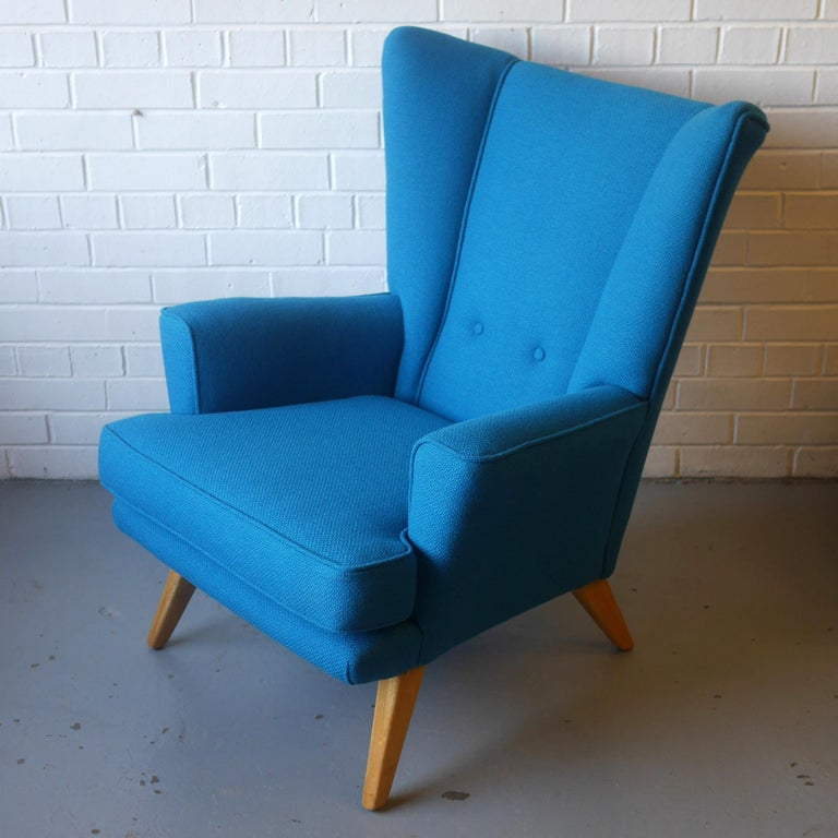 A wonderful example of a mid-1950s British wingback chair, a model 406 manufactured by G-Plan circa 1956 produced until circa 1961 and a model 405 footstool, a rare opportunity to get a matching set. Fully restored and finished in a richly textured