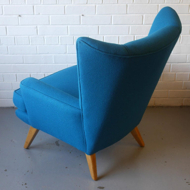 Mid-Century Modern G-Plan Wingback Armchair and Footstool in Blue Wool with Beech Legs, circa 1956 For Sale