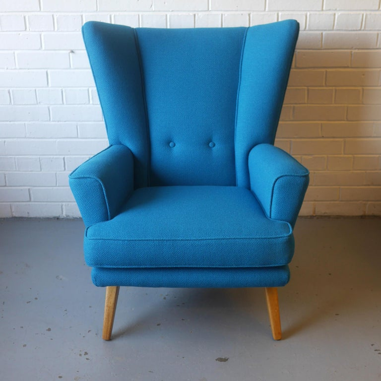 British G-Plan Wingback Armchair and Footstool in Blue Wool with Beech Legs, circa 1956 For Sale