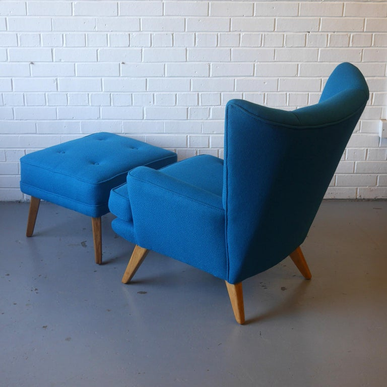 Mid-20th Century G-Plan Wingback Armchair and Footstool in Blue Wool with Beech Legs, circa 1956 For Sale