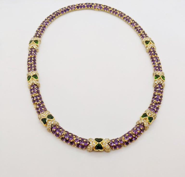 This necklace was designed by G. Verdi of Italy. The round brilliant cut Amethyst stones are set in 18 karat  yellow gold  links with prongs that give a beautiful beaded effect. Round brilliant Diamonds along with 14 heart shaped Tsavorites join the
