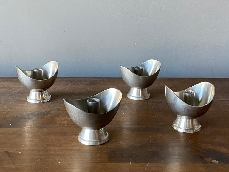 A set of modernist candlesticks. Designed and produced by GAB, Guldsmedsaktiebolaget, Sweden, 1930s. Marked. In Pewter.   Two pairs, each pair of slightly different shape.