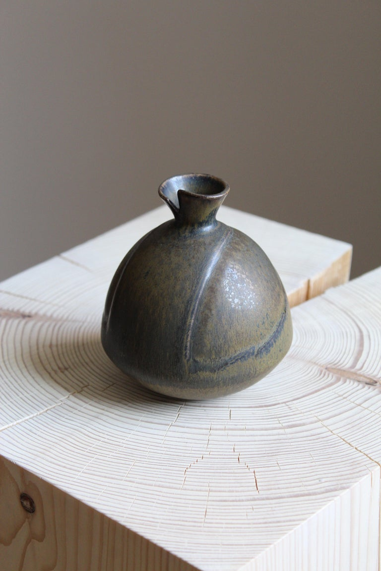 An organically shaped small stoneware vase by Gabi Citron Tengborg for the iconic Swedish firm Gustavsberg.   Other ceramicists of the period include Berndt Friberg, Axel Salto, Carl-Harry Stålhane and Wilhelm Kåge.