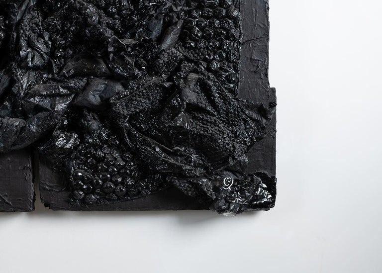 With his series of intense black mixed-media paintings, artist Gabriel Shuldiner captures the void simultaneously created by and filled up by technology. By layering the paintings with many different forms of media (chemical compounds, detritus,