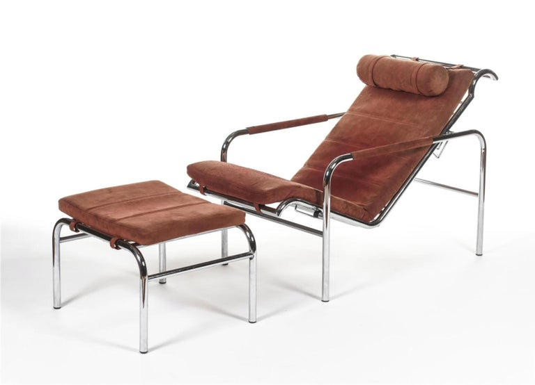 Gabriele Mucchi Armchair and its ottoman Genni Chrome-plated metal frame and red alcantara-covered foam trim Publisher label Numbered Edition Zanotta, circa 1979, based on a 1935 model Measures: Armchair: H 80 x D 50 x W 105 Ottoman H 40 x W