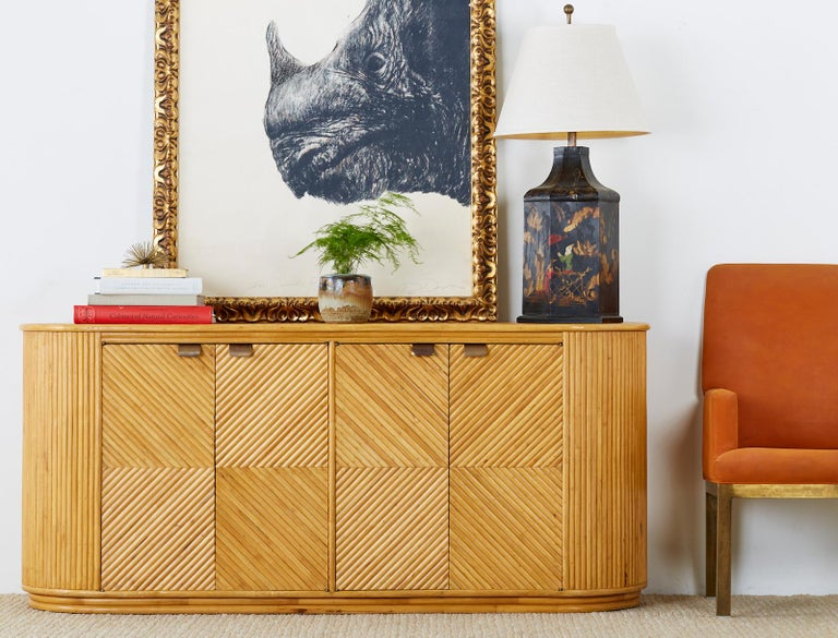 This sideboard server represents everything wonderful about the modern use of rattan. Incredible geometric patterns abound reminiscent of Art deco with modern shapes and lines. While touching modernism the rattan shape keeps the piece grounded in