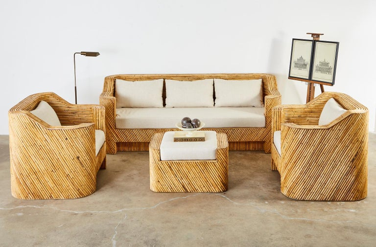 Impressive Hollywood Regency period Organic Modern living room suite comprised of a grand sofa, two lounge chairs and a matching ottoman. Constructed from split bamboo rattan this furniture set represents everything wonderful about the modern use of