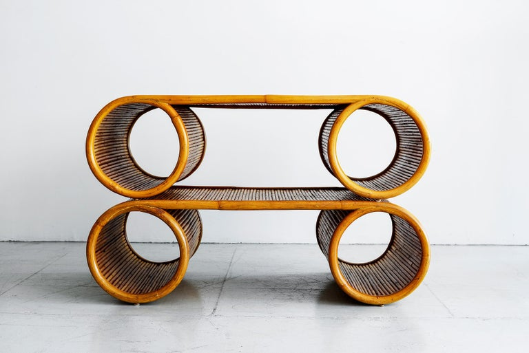 Large scale rattan coffee tables sculptural in shape and great condition. Pair available!