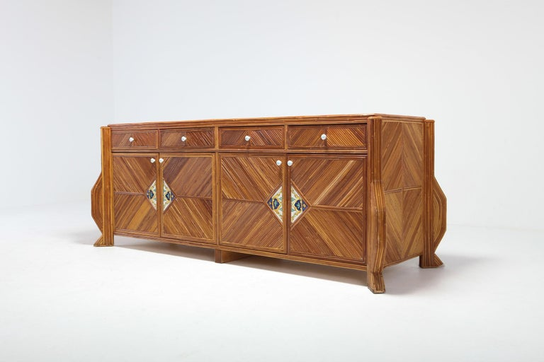Tropicalist bamboo sideboard by Vivai del Sud, Italy, 1970s.  Great Italian glam piece that fits well in an eclectic Hollywood Regency interior.  The credenza is finished front to back in the exact same way with four doors and four drawers. Hand