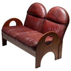 "Gae Aulenti ""Arcata"" Love Seat in Walnut and Burgundy Leather, 1968"